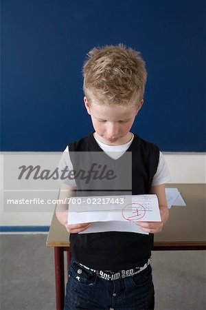 Unsuccessful Student with Test Result Stock Photo - Rights-Managed, Image code: 700-02217443