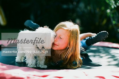 Girl with Dog on Trampoline, Costa Mesa, California, USA Stock Photo - Rights-Managed, Image code: 700-02217529