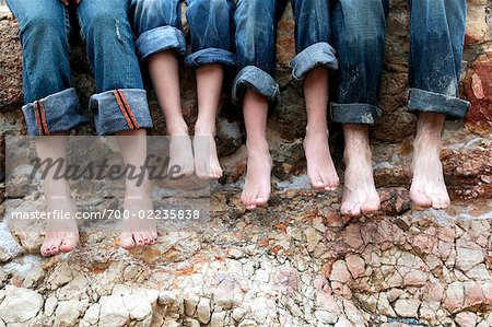 Family Sitting on Rocks at the Beach, Mallorca, Spain Stock Photo - Rights-Managed, Image code: 700-02235838