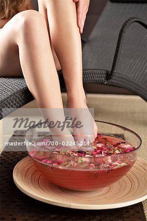 Woman Soaking Her Feet in Scented Water Stock Photo - Rights-Managed, Image code: 700-02245014
