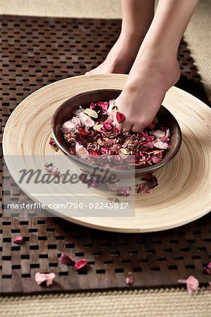 Woman Soaking Her Feet in Scented Water Stock Photo - Rights-Managed, Image code: 700-02245017