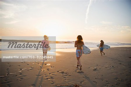 Surfers Walking on the Beach at Sunset, Encinitas, San Diego County, California, USA