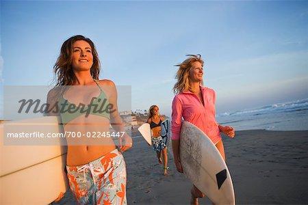 Surfers Walking on the Beach at Sunset, Encinitas, San Diego County, California, USA