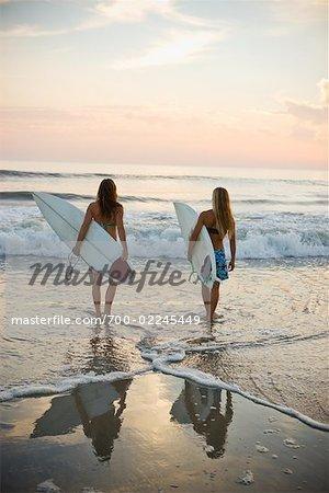 Surfers on the Beach at Sunset, Encinitas, San Diego County, California, USA