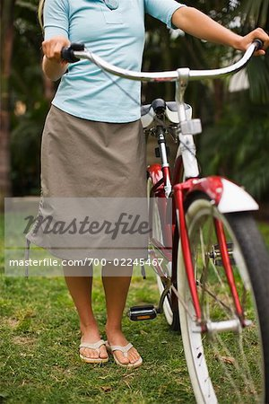 Woman Standing With Cruiser Bike, Encinitas, San Diego County, California, USA Stock Photo - Rights-Managed, Image code: 700-02245467