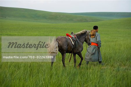 Horseman Walking with Horse, Inner Mongolia, China Stock Photo - Rights-Managed, Image code: 700-02263889