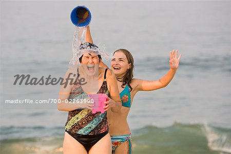 Daughter Pouring Pail of Water on Mother's Head at the Beach, New Jersey, USA Stock Photo - Rights-Managed, Image code: 700-02263990