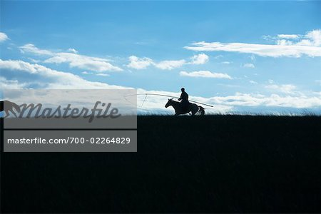 Silhouette of Horsmean Herding Horses, Inner Mongolia, China Stock Photo - Rights-Managed, Image code: 700-02264829