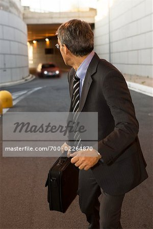 Businessman Running from Car Stock Photo - Rights-Managed, Image code: 700-02264870