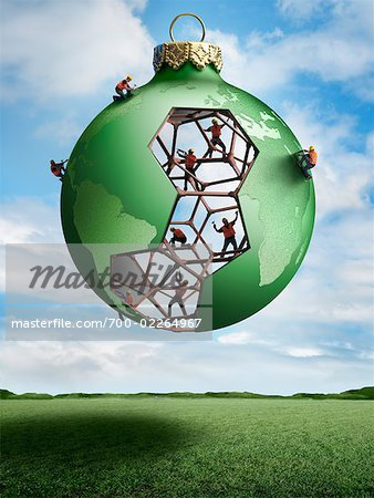 Construction Workers Building a Christmas Ornament Globe Stock Photo - Rights-Managed, Image code: 700-02264967