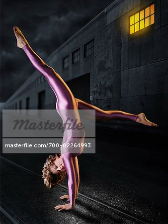 Gymnast Doing a Handstand Outdoors at night Stock Photo - Rights-Managed, Image code: 700-02264993