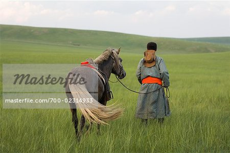 Horseman Walking with Horse, Inner Mongolia, China Stock Photo - Rights-Managed, Image code: 700-02314933