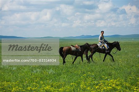 Horseman Leading Horse, Inner Mongolia, China Stock Photo - Rights-Managed, Image code: 700-02314934