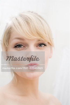 Portrait of Woman Puckering Mouth Stock Photo - Rights-Managed, Image code: 700-02345969