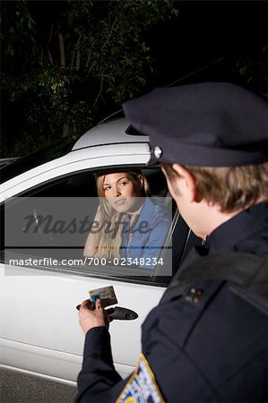 Police Officer Pulling Woman Over, Toronto, Ontario, Canada Stock Photo - Rights-Managed, Image code: 700-02348234