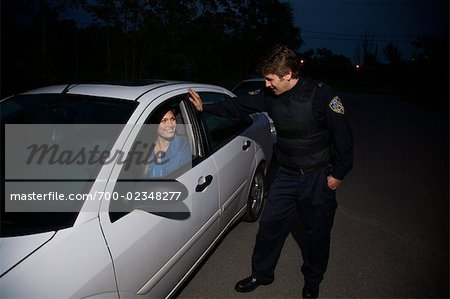 Police Officer Pulling Woman Over, Toronto, Ontario, Canada Stock Photo - Rights-Managed, Image code: 700-02348277