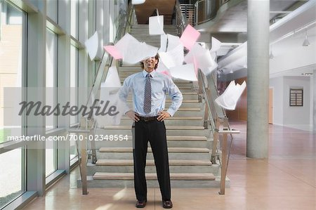 Businessman Throwing Papers Up in the Air Stock Photo - Rights-Managed, Image code: 700-02348554