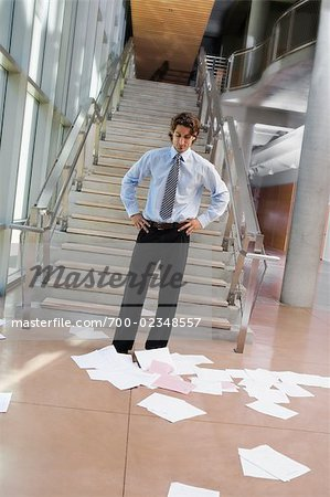 Businessman Looking at Papers Scattered on the Floor Stock Photo - Rights-Managed, Image code: 700-02348557