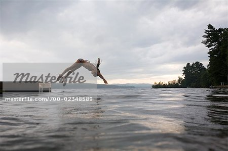Girl Diving off Floating Dock, Naples, Maine, USA Stock Photo - Rights-Managed, Image code: 700-02348589