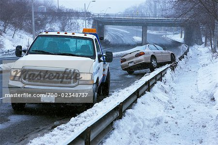 Tow Truck and Car Stuck on Guard Rail on Icy Highway, Toronto, Ontario, Canada Stock Photo - Rights-Managed, Image code: 700-02348737
