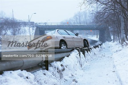 Tow Truck Pulling Car Off Guard Rail on Icy Highway, Toronto, Ontario, Canada Stock Photo - Rights-Managed, Image code: 700-02348738