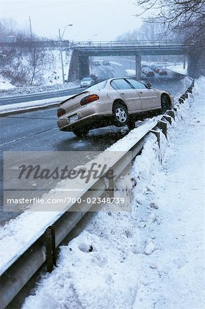 Tow Truck Pulling Car Off Guard Rail on Icy Highway, Toronto, Ontario, Canada Stock Photo - Rights-Managed, Image code: 700-02348739