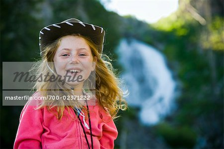 Portrait of Girl Wearing Cowboy Hat, Yellowstone National Park, Wyoming, USA