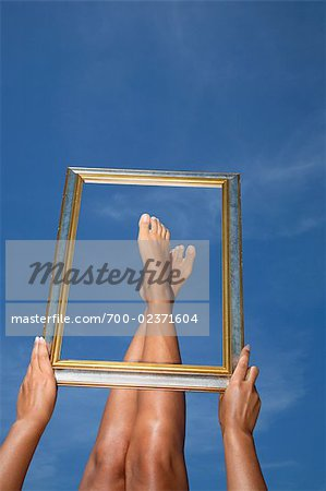 Woman Framing her Feet Stock Photo - Rights-Managed, Image code: 700-02371604