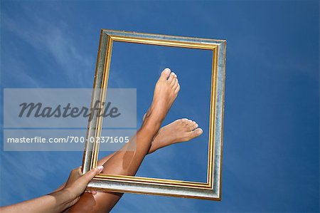 Woman Framing her Feet Stock Photo - Rights-Managed, Image code: 700-02371605