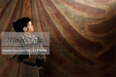 Medieval Boy Listing to Headphones, Mugello, Tuscany, Italy Stock Photo - Rights-Managed, Image code: 700-02376738