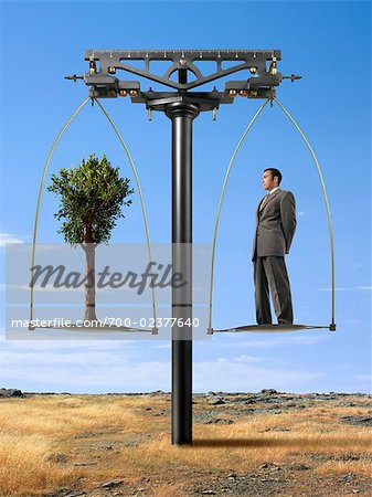 Businessman and Tree on Balance Scale Stock Photo - Rights-Managed, Image code: 700-02377640