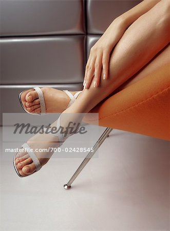 Legs of Woman in Chair Stock Photo - Rights-Managed, Image code: 700-02428545