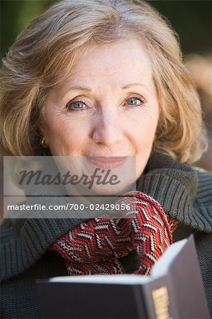 Portrait of Woman Reading Outdoors Stock Photo - Rights-Managed, Image code: 700-02429056