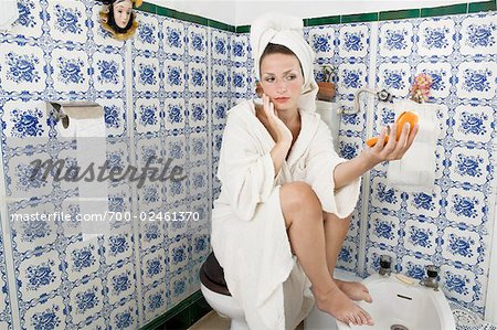 Woman Looking at Self with Compact Mirror Stock Photo - Rights-Managed, Image code: 700-02461370