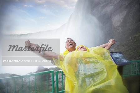 Couple Having Fun in the Mist Under Niagara Falls, Ontario, Canada