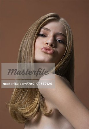 Woman Puckering Lips Stock Photo - Rights-Managed, Image code: 700-02519126