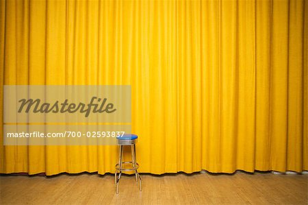 Stool on Stage with Yellow Curtains Stock Photo - Rights-Managed, Image code: 700-02593837