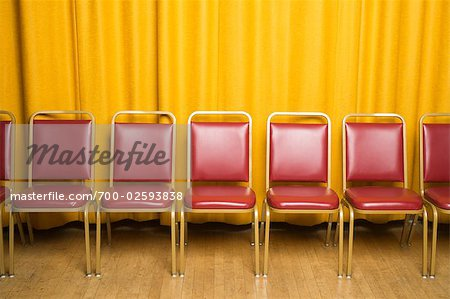 Chairs on Stage with Yellow Curtains Stock Photo - Rights-Managed, Image code: 700-02593838