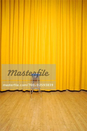 Stool on Stage with Yellow Curtains Stock Photo - Rights-Managed, Image code: 700-02593839