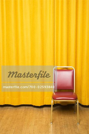 Stool on Stage with Yellow Curtains Stock Photo - Rights-Managed, Image code: 700-02593840