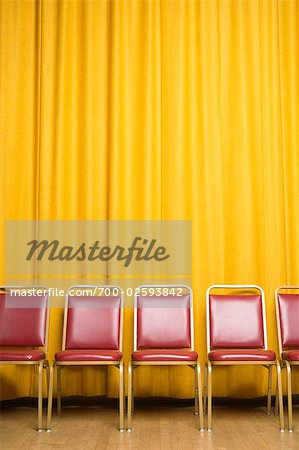 Chairs on Stage with Yellow Curtains Stock Photo - Rights-Managed, Image code: 700-02593842