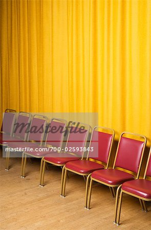 Chairs on Stage with Yellow Curtains Stock Photo - Rights-Managed, Image code: 700-02593843