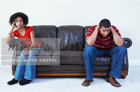 Couple Ignoring Each Other on Sofa Stock Photo - Rights-Managed, Image code: 700-02637901
