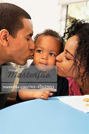 Parents Kissing Toddler Stock Photo - Rights-Managed, Image code: 700-02637953