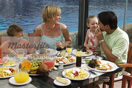 Family Eating Lunch Outdoors Stock Photo - Rights-Managed, Image code: 700-02638161
