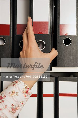 Businesswoman Reaching for File Folder Stock Photo - Rights-Managed, Image code: 700-02638192