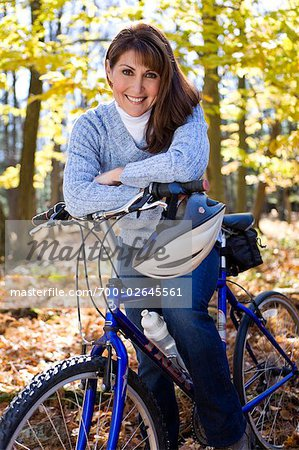 Portrait of Woman Riding Her Bike in a Forest in Autumn Stock Photo - Rights-Managed, Image code: 700-02645561
