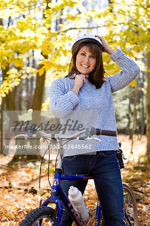 Woman Riding Her Bike in a Forest in Autumn Stock Photo - Rights-Managed, Image code: 700-02645562