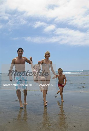 Family Walking along Beach Stock Photo - Rights-Managed, Image code: 700-02645913