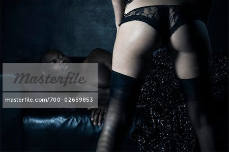 Woman in Lingerie Standing in Front of Man Stock Photo - Rights-Managed, Image code: 700-02659853